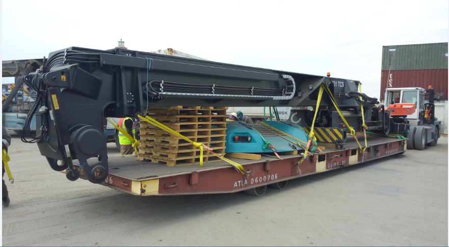 Boom and spreader being delivered ready for commissioning.